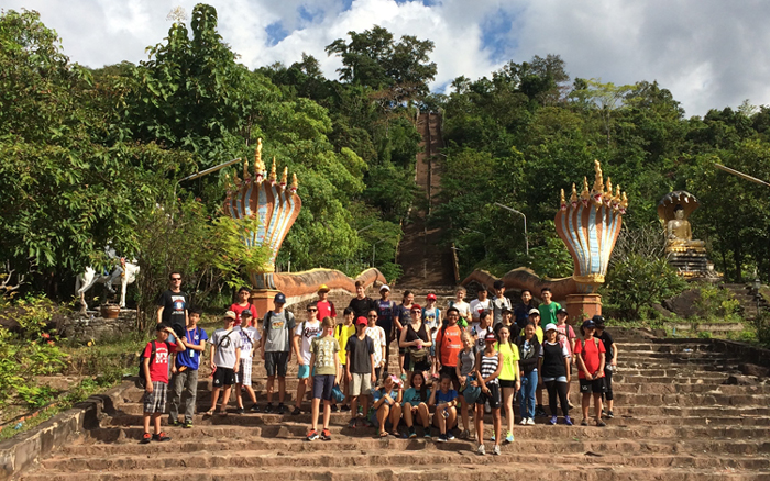 Grade 8 SALSA 2015 about to ascend the stairs toward Phu Salao just outside Pakse